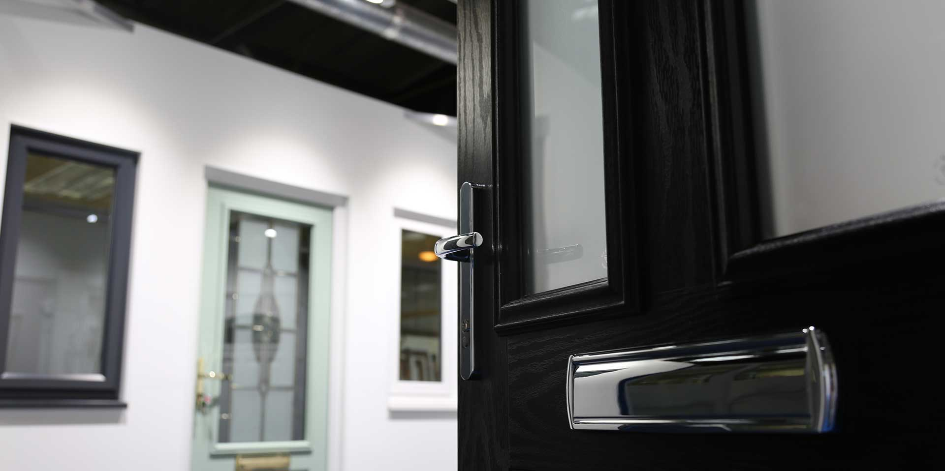 Black composite door in our product showroom