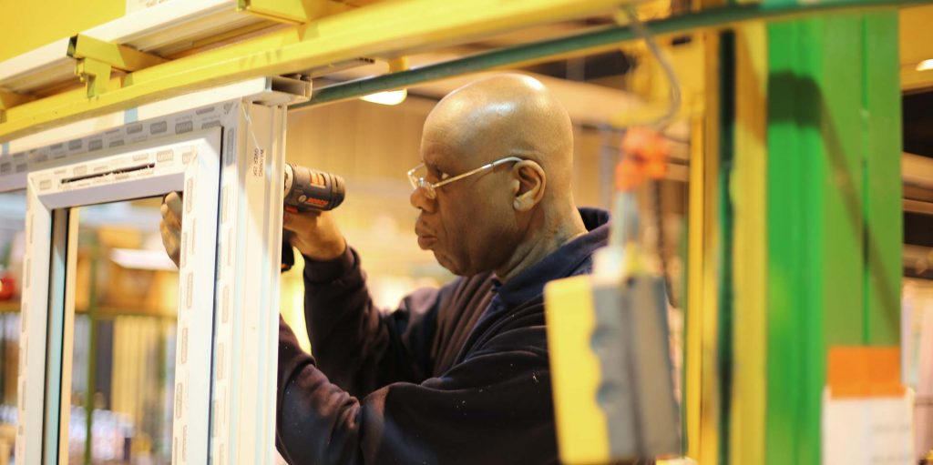 One of our engineers working on a newly manufactured window frame