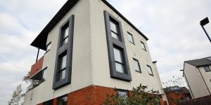 New build property with casement windows in grey PVCu