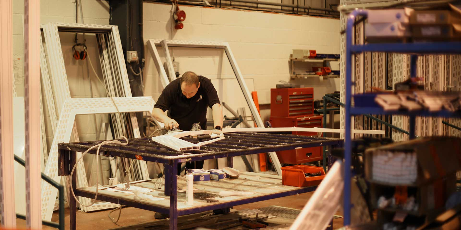 One of our long serving employees working on a PVCu frame