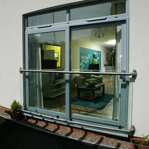 Sliding patio door in light grey PVCu material supplied for apartment block refurbishment