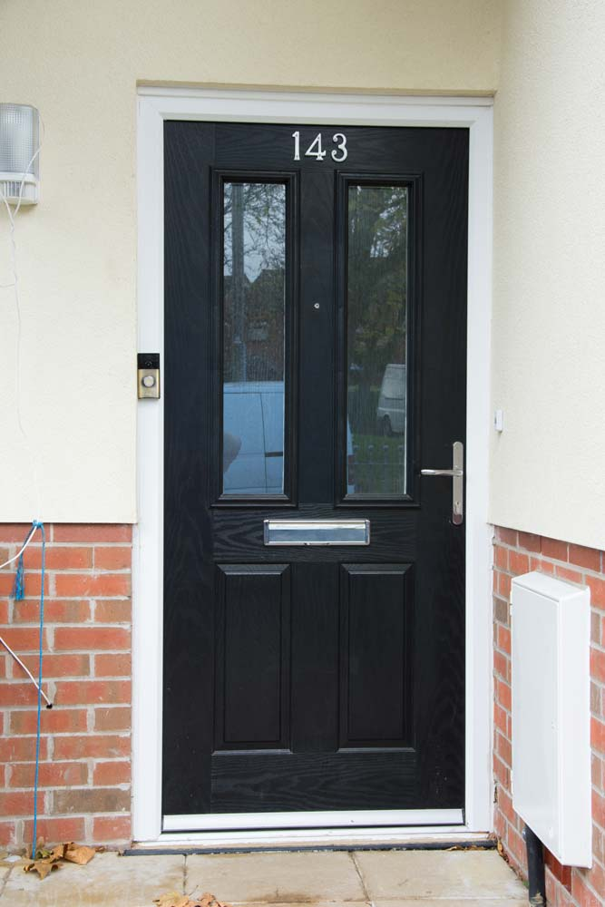Black composite door with chrome hardware