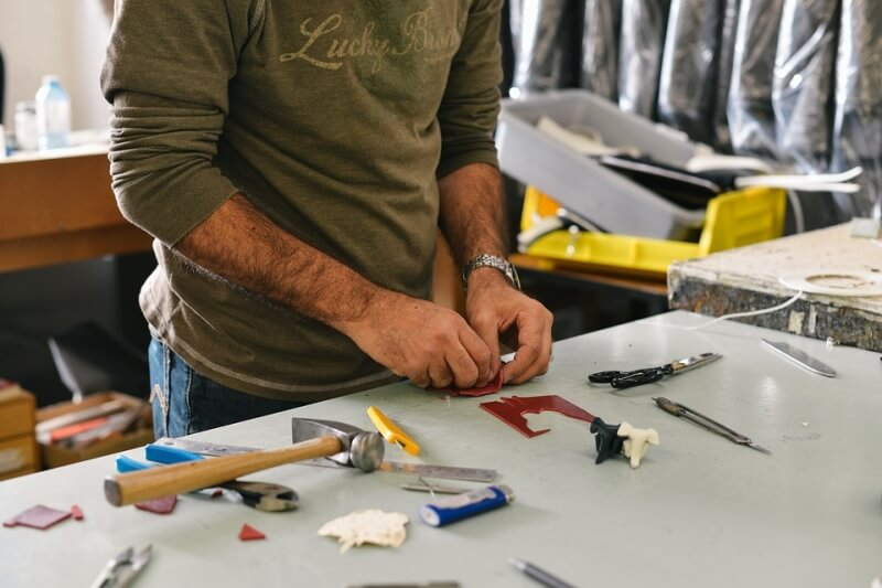 Worker on a table with tools and materials