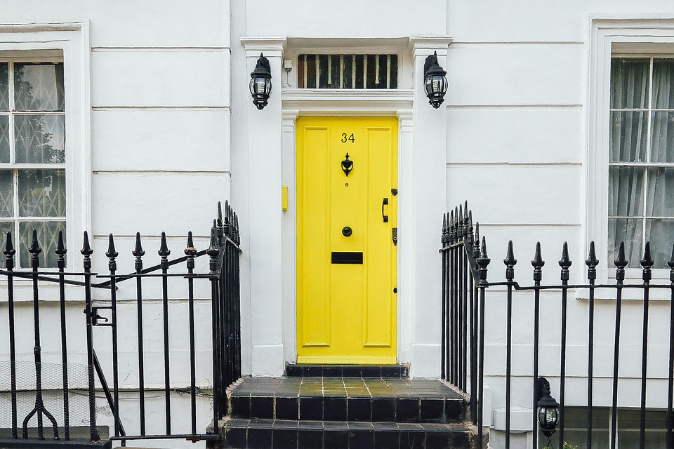 Bespoke yellow door on white house