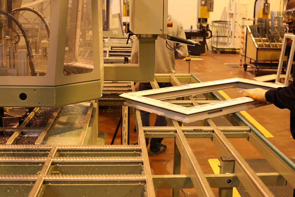 Workers manufacturing uPVC frame
