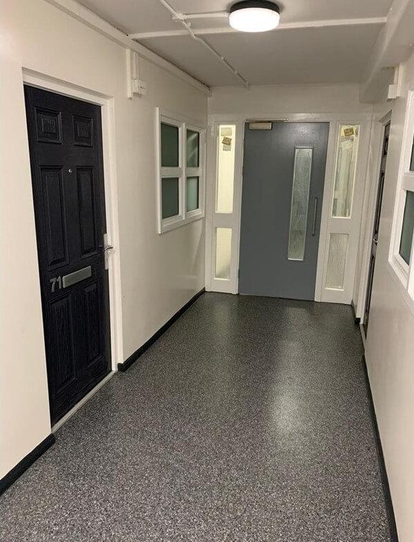 Fire door in hallway in block of flats.